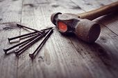 Hammer and nails on floorboards concept for construction, diy, tools and home improvement poster