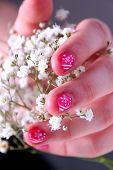 Nail art - Hand holding flowers.