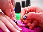 Nail Artist at work.