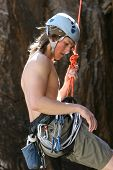 picture of sling bag  - A teenager is lowered down after completing a rock climb - JPG