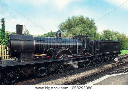 Old Steam Locomotive On Railroad