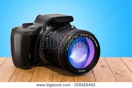 poster of Digital Single-lens Reflex Camera On The Wooden Desk, 3d Rendering