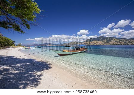 A Boat On Tropical Beach
