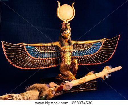 Egyptian Goddess Isis Kneeling With