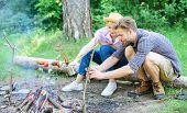 Tourists Sit Log Near Bonfire Taking Photo On Smartphone. Couple On Vacation Capture Moment. Man Tak poster