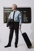 Man In Shirt With Bag In Airport In Waiting Room. Senior Person In Airport. Tourism Concepts. Busine poster