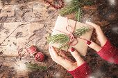 Womans Hands Give Christmas Gift poster