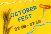 Germany October Fest Concept. Wheat, Fork With Sausage With Mustard And Blue Wooden Text october Fe poster