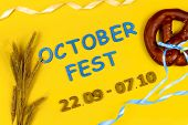 October Fest Concept. Wheat, Sweet Tasty Bread Snack Pretzel And Blue Wooden Text october Fest 22.0 poster