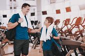 Young Father And Son Near Treadmills In Modern Gym. Healthy Lifestyle Concept. Sport And Training Co poster