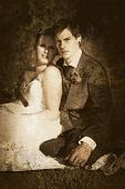 stock photo of olden days  - Grungy Faded Textured Vintage Wedding Photograph Of A Endearing Couple Embrace Each Others Presence In A Image Depicting Olden Day Nostalgia And Passing Time - JPG