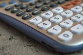 Close Up Of A White Scientific Calculator With A Shallow Depth Of Field poster