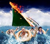 stock photo of hysterics  - Trouble In Paradise Concept With Five Hysterical Tourists Wearing Life Rings Scream And Wave In The Ocean For Help And Rescue After An Accident Sinks Their Boat - JPG