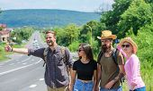 Friends Hitchhikers Travelling Sunny Day. Company Friends Travelers Hitchhiking At Edge Road Nature  poster