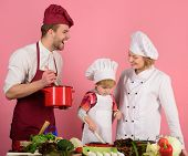Mom, Dad And Kid With Busy Face Cooking Food Together. Happy Family, Childhood, Food, Cooking Concep poster