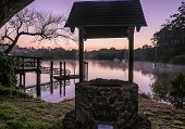 Wishing Well Overlooking Kerikeri Inlet With Morning Mist Over Water. Photographed At Dawn At Korori poster