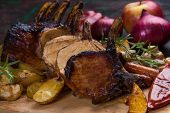 Roasted rack of pork, pork loin roast with frenched ribs poster