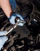 Mechanic Using Wrench To Perform Engine Maintenance