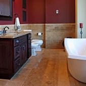 image of bathroom sink  - An upscale bathroom with inlaid stone tile flooring and granite countertops - JPG
