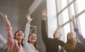 Successful Of Business People Celebrating In Office. Group Of Happy Business Team Hands Raised For S poster