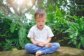 Cute Little Asian 30 Months / 2 Years Old Toddler Baby Boy Child With Eyes Closed, Barefoot Practice poster