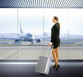 Business traveler with luggage in airport