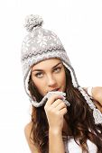 beautiful woman playing with the pompom of her winter cap