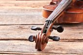 Close Up Violin On Old Wooden Surface. Detail Of Musical Instrument Viola. Cello Close Up Of Scroll  poster