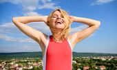Girl Pleased With Warm Sunlight Looks Relaxed Blue Sky Background. Take Care Skin Armpit. Woman Blon poster