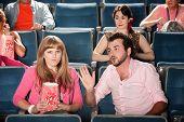 Man Talks To Woman In Theater