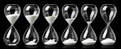 Collection of hourglasses with white sand showing the passage of time poster