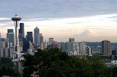 mt raineer and seattle skyline at dusk