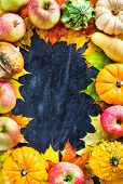 Autumnal Frame With Colorful Pumpkins, Apples And Fallen Leaves On Dark Background With Copy Space F poster