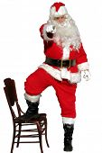isolated santa stands with one finger pointed toward you the viewer