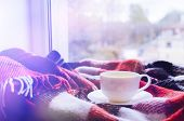 Cup Of Tea With Lemon And Warm Woolen Blanket On Window Sill. Hot Drink For Rainy Days. Hygge Concep poster
