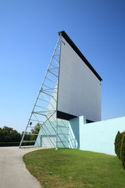 foto of matinee  - Drive In Theater movie screen against a sunny blue sky - JPG