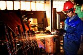 An industrial background. Welder in a factory