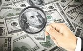 dollar bill under a magnifying glass