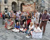 EDINBURGH- AUGUST 11: Members of Lancaster Offshoots publicize their show Trojan Women during Edinburgh Fringe Festival on August 11, 2012 in Edinburgh