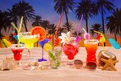stock photo of mojito  - beach tropical cocktails on white sand mojito blue hawaii on sunset palm trees - JPG