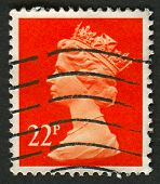 UK-CIRCA 1990:A stamp printed in UK shows image of Elizabeth II is the constitutional monarch of 16 sovereign states known as the Commonwealth realms, in red, circa 1990.