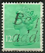 UK-CIRCA 1982:A stamp printed in UK shows image of Elizabeth II is the constitutional monarch of 16 sovereign states known as the Commonwealth realms, in Light Emerald, circa 1982.