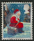 UK - CIRCA 2006: A stamp printed in UK shows image of the Father Christmas on Chimney, circa 2006.