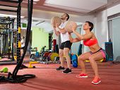 foto of concentration man  - Crossfit ball fitness workout group woman and man at gym - JPG