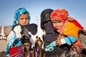 HURGHADA, EGYPT - APR 10: Unidentified arabic family with goat and donkey on the local bus station n