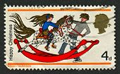 UK - CIRCA 1968: A stamp printed in UK shows image of the Girl and Boy with Rocking Horse , circa 19