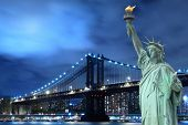 foto of statue liberty  - Manhattan Bridge and The Statue of Liberty at Night - JPG