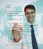 Smiling businessman writing sql language on white background
