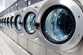 image of laundromat  - A row of industrial washing machines in a public laundromat - JPG