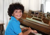 Young mixed race boy with piano